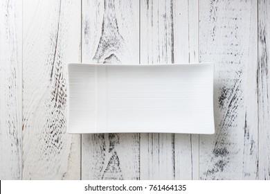 White rectangular Plate on white wooden table background