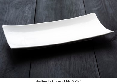 a white rectangular plate with rounded corners
