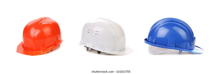White red and blue hard hats. Isolated on a white background.