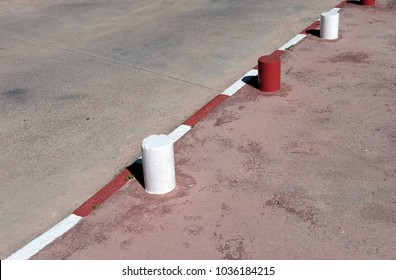 white and red borders of the road