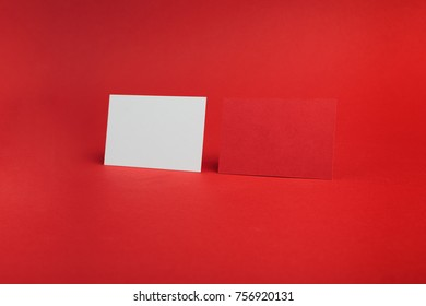 White and red business card on red background