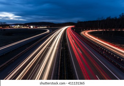 white and red car light trails on motorway junction