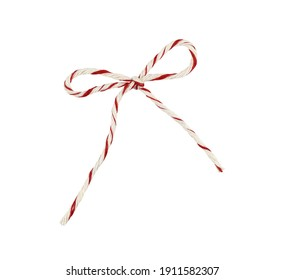 White and red Christmas wrapping rope tied in a bow isolated on white background