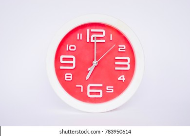 White and red clock at 7 o'clock On a white background