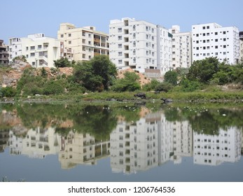 white, red color Buildings, Hyderabad India, Water mirror / reflection effect in lake