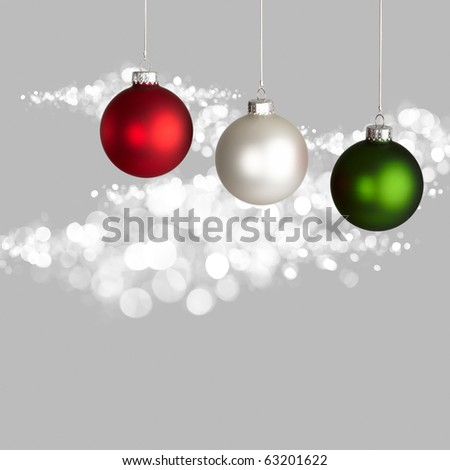 white red and green christmas ornaments on gray and white bokeh background