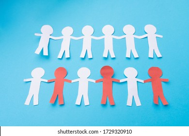 White and red paper people holding hands. Blue background.