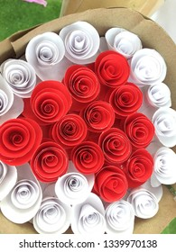White and red paper rolls like roses.