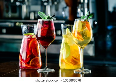 White and red sangria with fruit and ice. Summer alcohol drink and ingredients. sangria with red and white wine