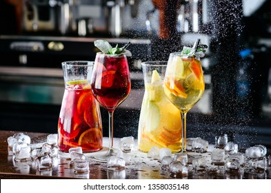 White and red sangria with fruit and ice. Summer alcohol drink and ingredients. sangria with red and white wine, menu in a summer restaurant