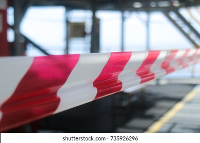 White and red strip barrier tape