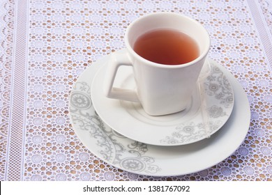 White with red tea cup and pyrex with drawings of flowers