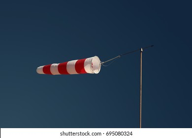 White and red windsock. Rosignano. Italy.