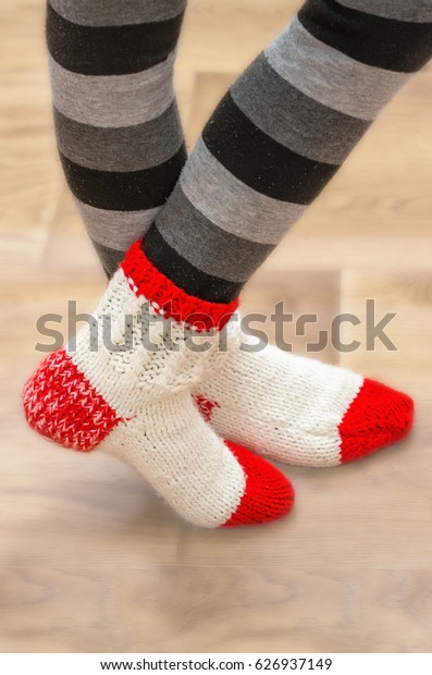 White red woolen socks on legs