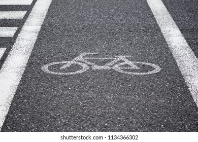 white reflective painted bicycle sign, bicycle lane on the road for pedestrian crossing