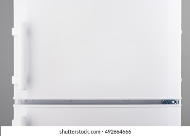 White refrigerator on gray background