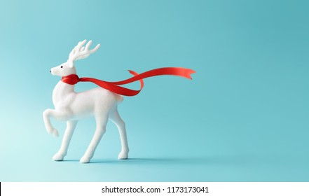 White reindeer with red scarf on pastel blue background. Christmas or New Year minimal concept.