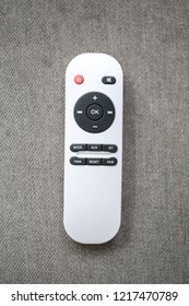 white remote control  on cotton background