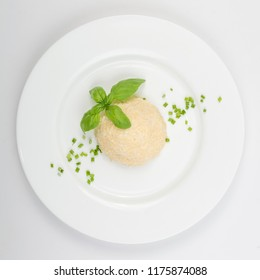 White Restaurant Plate of Feta Cheese Spreading Mezze with Garlic, Green Onion and Basil. Finely Grated Emmental and Maasdam Cheeses Fragrant Spice Paste or Pate Mixed with Mayonnaise Top View