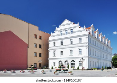 White restored hotel building on the square Sovietskaja in Grodno, Belarus.