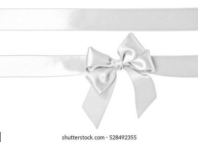 White ribbon and bow isolated on the white background