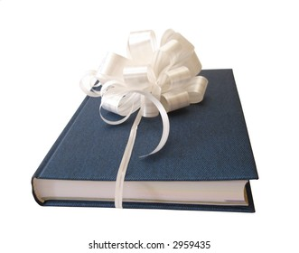 white ribbon tied blue book over white background