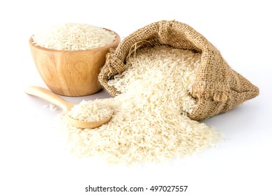 White rice in bowl and a bag and a wooden spoon on white background, Top view with copy space