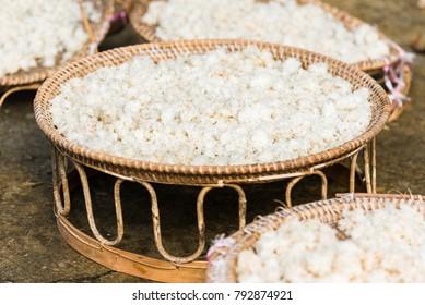 White rice in large baskets outdoors, Luang Prabang, Laos. Close-up