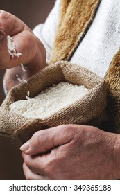 white rice in old hand