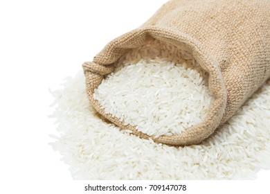 White rice in sack bag isolated on white background