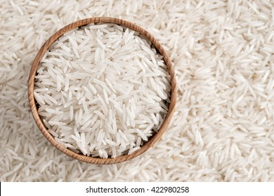 White rice in wooden bowl. Close up, top view, high resolution product.