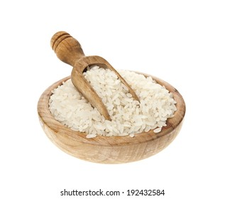 White rice in a wooden bowl and scoop on a white background.