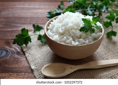 White rice in wooden bowl. Top view. Diet food. Vegetarian and vegan food.