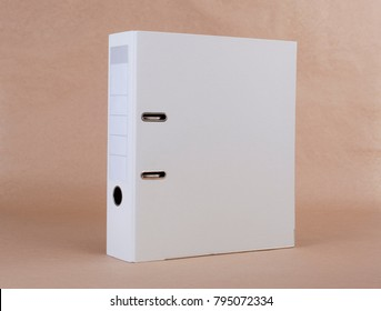 A white ring binder on beige background