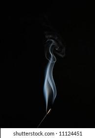 white rising smoke from aromatic stick