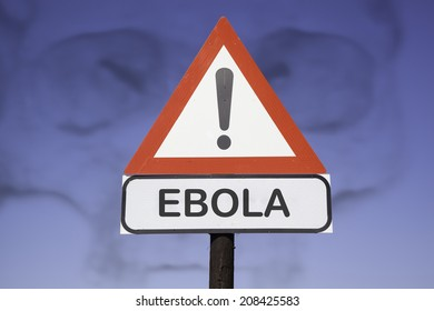 White road warning triangle with black  exclamation point and red frame on  a wooden mast in front of a blue sky. A second rectangular sign warns in english about ebola