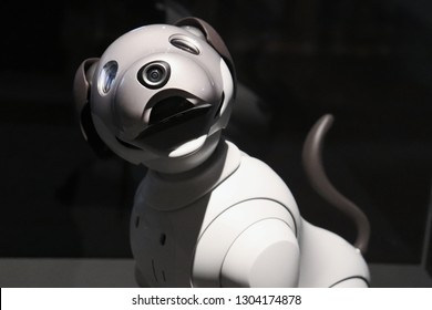 white robot dog smiling.
