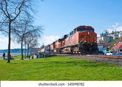 WHITE ROCK, CANADA - APRIL 15: BNSF coal train on April 15, 2013 in White Rock, BC, Canada. BNSF is owned by Warren Buffetts Berkshire Hathaway Inc.