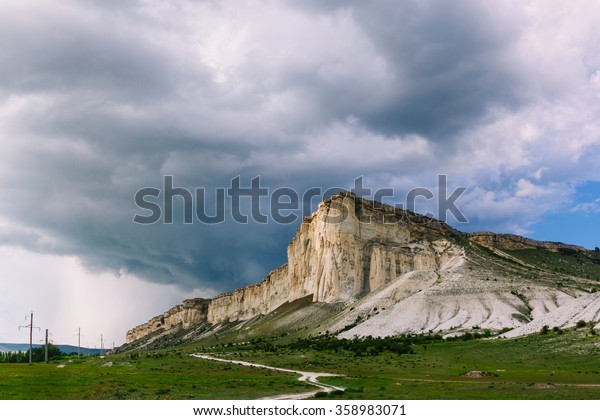 White Rock in the Crimea. White stone against a cloudy sky. Before the rain