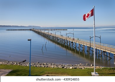 White Rock Pier BC, Canada. White Rock and it's pier is a popular tourist destination on the west coast of British Columbia near the United States border.
