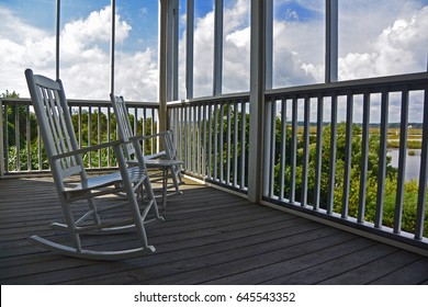 White Rocking Chairs on Screened In Porch