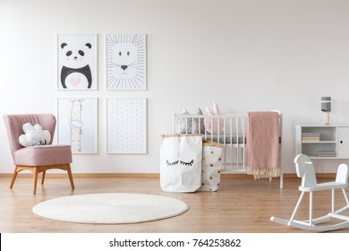 White rocking horse and carpet in child's room with pink armchair, paper bags, drawings and bed