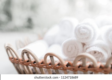 White roll towel in vintage basket.