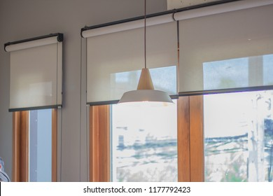White roller blind and window.