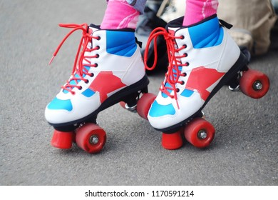 white rollers for riding with red wheels and red laces, the theme of roller skating and rest