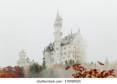 White romantic castle in mist in autumn. Copy space for text