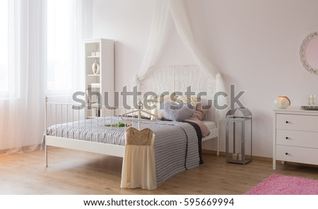 White Room With Canopy Bed Bookshelf And Dresser
