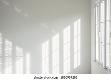 White room, glass windows, combined with the sunlight on the wall. - Shutterstock ID 1880959288
