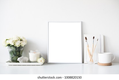 White room interior decor with burning candle, poster mockup and