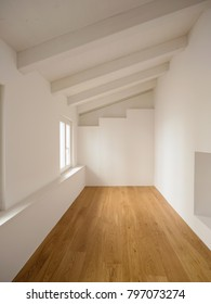 White room. On the wall there is a staircase. Nobody inside